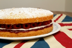 Victoria Sponge with raspberry jam, raspberries and cream cheese icing.