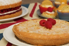 Bakewell Tart with almonds and glacé icing. Victoria Sponge with raspberry jam, raspberries and cream cheese icing and fairy cakes.