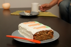 Carrot Cake with cream cheese icing and coloured icing to make the carrots on top.