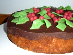 Orange flavoured sponge cake, chocolate icing on top with marzipan decorations.