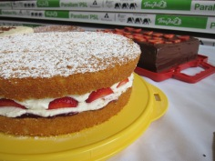 Victoria sponge with maple syrup cream and strawberries.