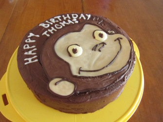Chocolate cake with chocolate buttercream icing and face made of chocolate.