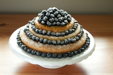 Lemon drizzle cake with blueberries. Top layer dairy free lemon cake.