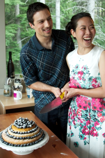 Lemon Drizzle with Blueberries and the top layer is dairy free. Jess & Sven cutting the cake.
