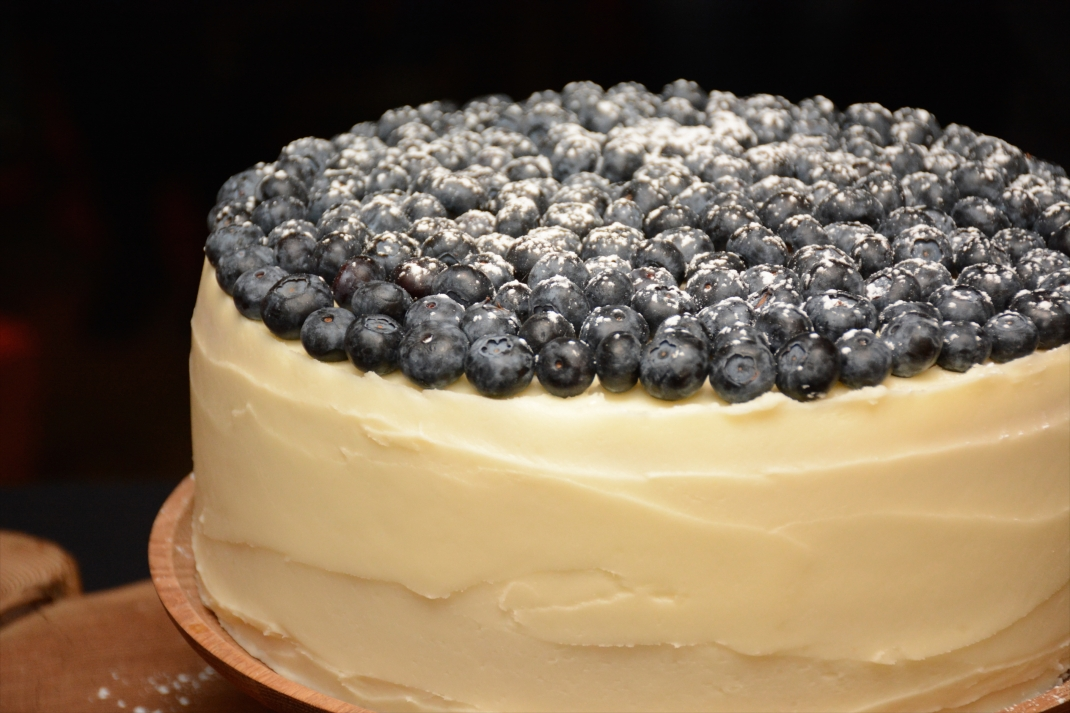 Pink vanilla sponge with lemon buttercream icing with blueberries.