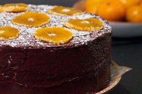 Chocolate cake with chocolate and clementine ganache icing and clementine slices.