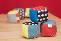 Fabric stacking cube shaped blocks for babys.