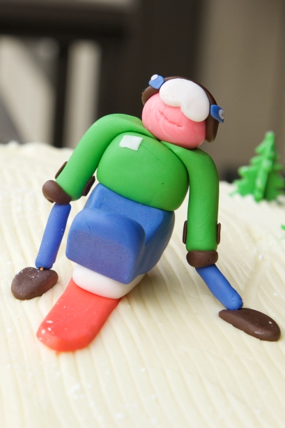 Vanilla sponge with lemon buttercream icing. and sit-skier/trees made out of Fondant icing