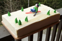 Vanilla sponge with lemon buttercream icing. and sit-skier/trees made out of Fondant icing.