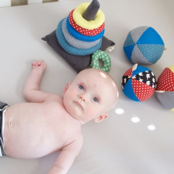 Annabel with her Fabric stacking rings fabric baby ball toys.