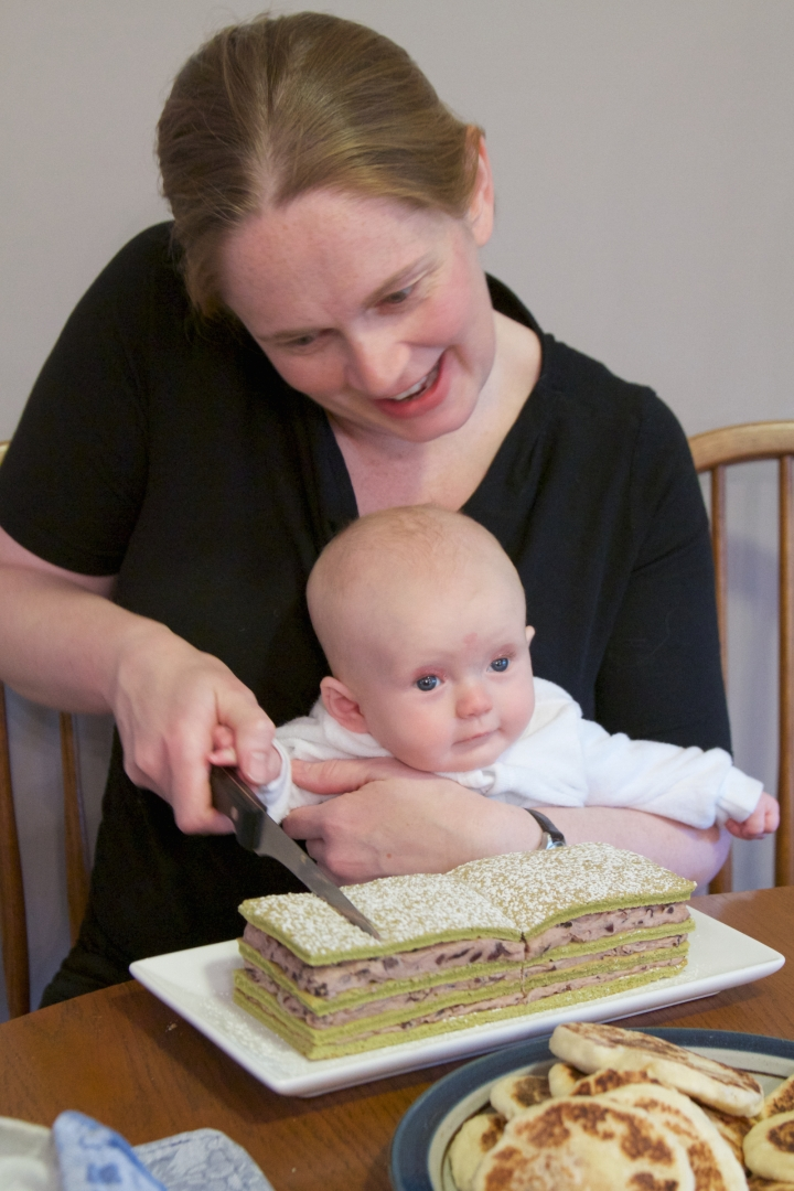 Annabel and Abi cutting her 100 Day Birthday Cake. Green tea and red bean Cake. Matcha green tea sponge with sweet Adzuki bean filling.