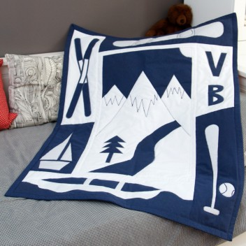 The finished quilt. Blue and white mountain quilt. Made from up-cycled fabric.