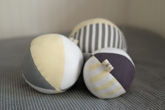 Set of three balls for Avi, grey, yellow and white.