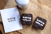 Gluten free & vegan chocolate brownies with stencilled icing sugar website logo.