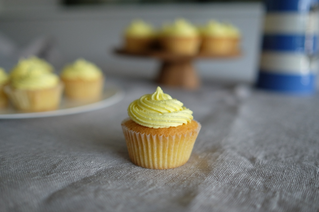 Vanilla cupcakes with lemon sunshine yellow icing.