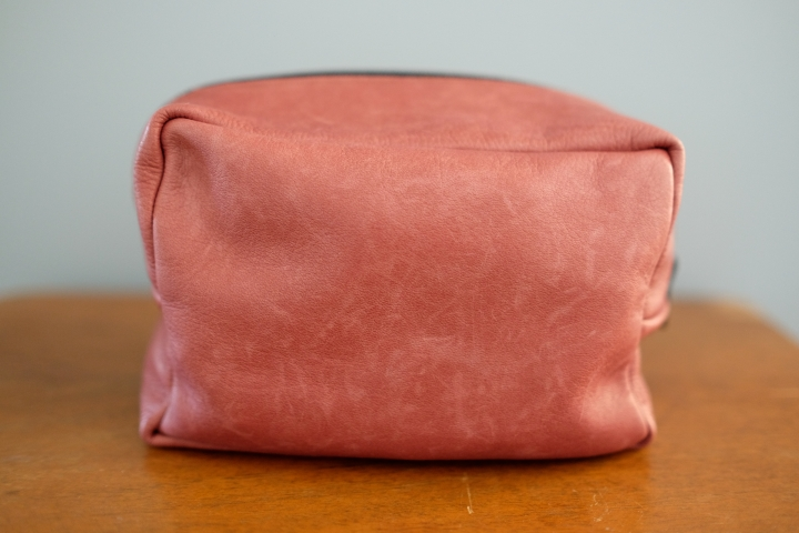 Side view of leather bag.