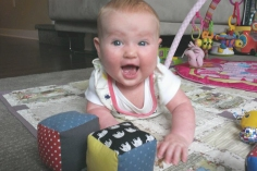 Isobel enjoying her cube block toys.